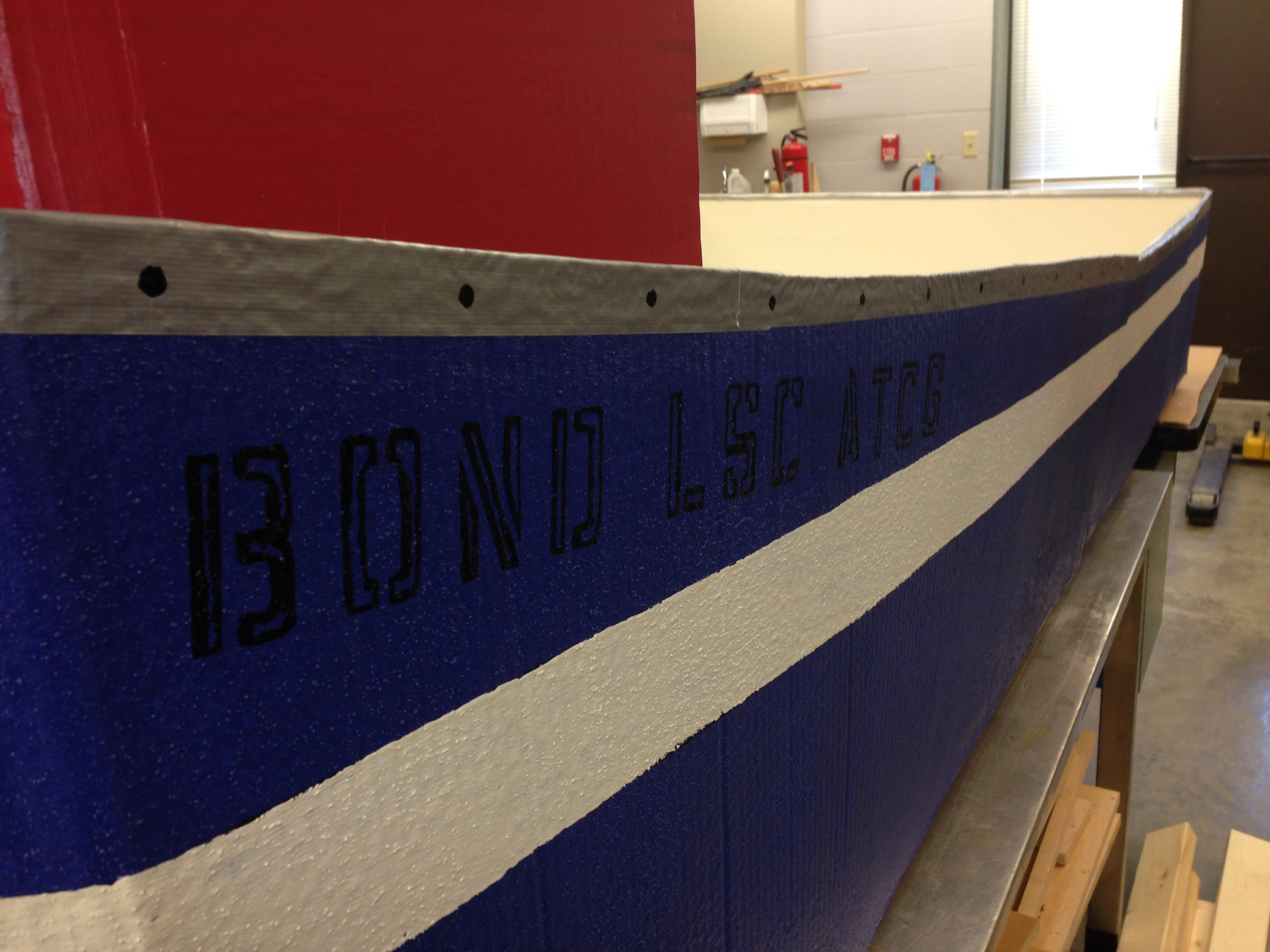 The Bond LSC ATCP is a streamlined, perfectly buoyant  cardboard boat. ATCP are the letters of DNA sequencing. — BLANKENBUEHLER