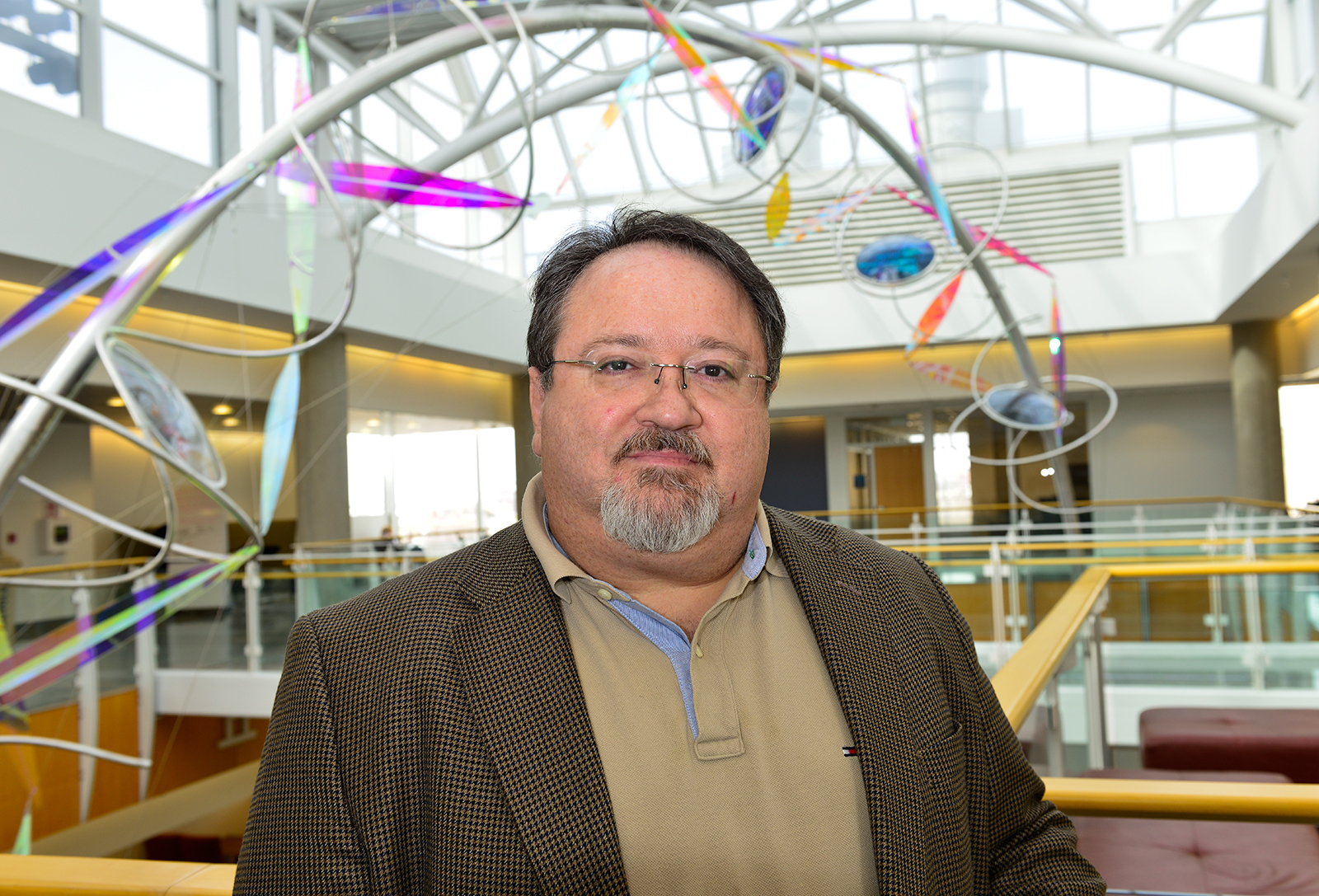 Virologist Stefan Sarafianos stands in the atrium of the Bond LSC.