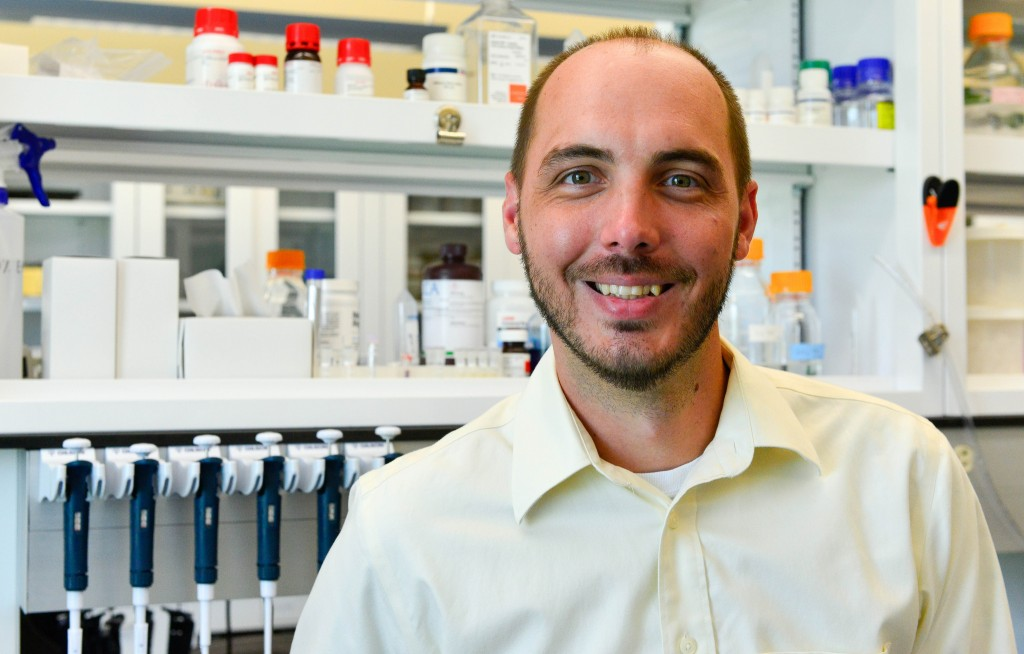 Daniel Davis, a PhD candidate and lab manager for Assistant Professor of Veterinary Pathobiology Catherine Hagan, is developing a technique to screen potential antidepressant drugs by leveraging CRISPR technology and the advantages of the zebrafish. //photo by CALEB O'BRIEN/Bond LSC