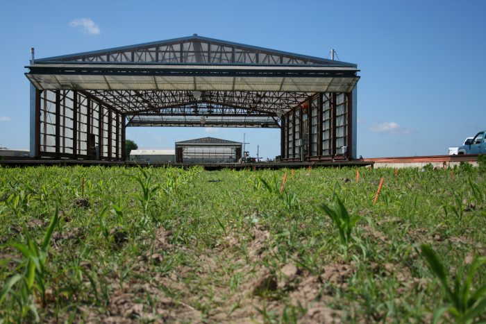 The Drought Simulator, created by Ph.D. candidate Shannon King, acts as a giant mobile greenhouse. Whenever inclement weather moves in, the greenhouse moves on top of the crop field to protect it from any precipitation. Photo by MJ Rogers, Roots in Drought Project